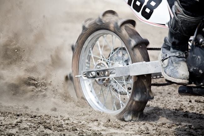 Paddle dirt bike tire in sand